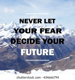 "Inspirational quote "" Never let your fear decide your future"" on blurred snow mountain background"
