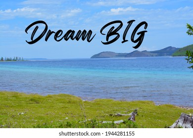Inspirational quote on a landscape with the text Dream big. Message or card. Concept of inspiration. Positive phrase. Poster, card, banner design. Motivational phrase.