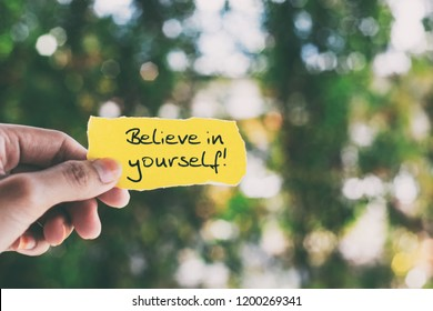 Inspirational quote on piece of paper - Believe in yourself.