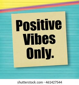 Inspirational quote Positive Vibes Only on yellow sticky note