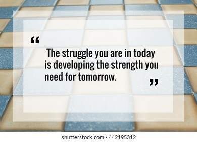 """Inspirational quote """"the struggle you are in today is developing the strength you need for tomorrow"""" on chess table background"""