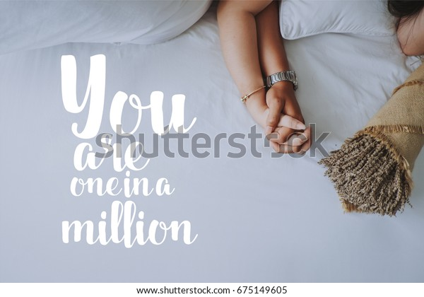 Inspirational quotes about love. Hand in hand of young couple background. You are one in a million.