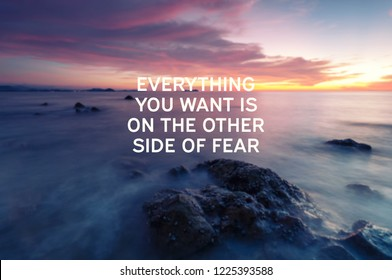 Inspirational quotes - Everything you want is on the other side of fear. Blurry background.