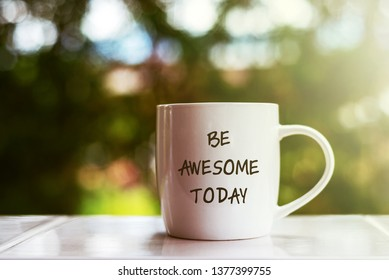 Inspirational quotes text on coffee mug - Be awesome today