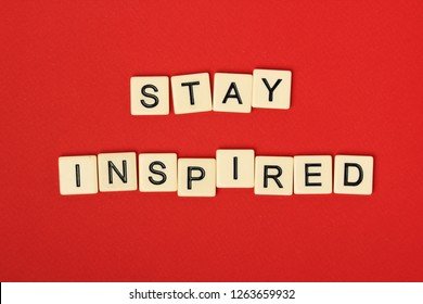 Inspirational sentence Stay inspired formed with game tiles