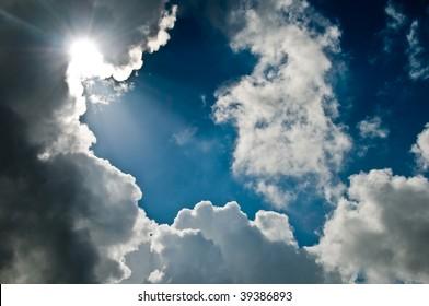 inspirational shafts of light breaking through dark clouds