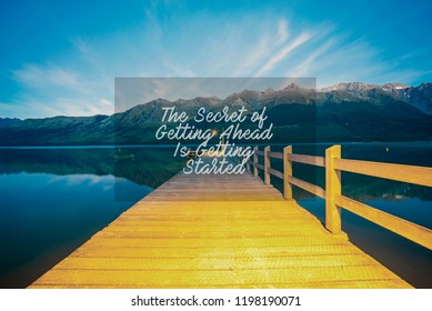 Inspirational success quotes on the mountain sunset background. The secret of getting ahead is getting started