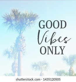 Inspirational Typographic Quote - Good vibes Only - with palm trees in background