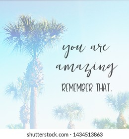 Inspirational Typographic Quote - You are amazing remember that - with palm trees in background
