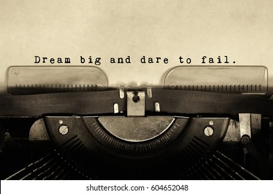 Inspirational words dream big and dare to fail words typed on vintage typewriter.
