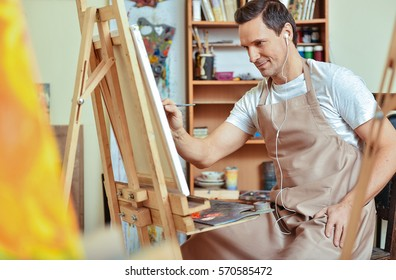 Inspired artist painting picture on a canvas