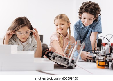Inspired kids testing cyber robots at school