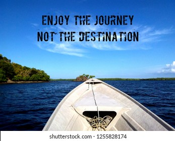 """Inspired motivation quotation """"Enjoy the journey not the destination""""with beautiful seascape as background (image contain certain grain or noise and soft focus when view at full resolution)."""