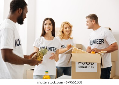 Inspired volunteers working on another shipment of foods
