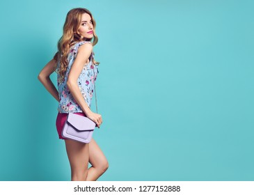 Inspired Young woman laughing dance in Studio. Blonde lovable Girl Having Fun, Trendy Wavy Hairstyle, Stylish fashion pink shorts. Happy positive emotion