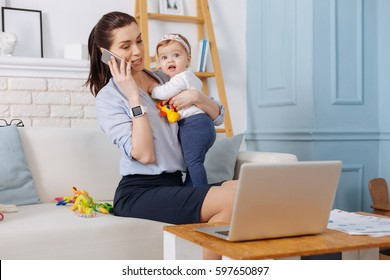 Inspiring charismatic mother calling her business partner