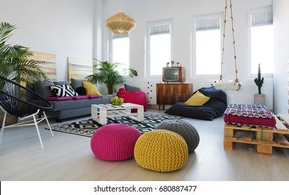 Inspiring colorful retro living room with swing in stylish loft