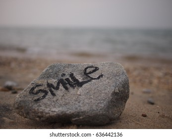 """Inspriational message """"Smile"""" at the beach"""