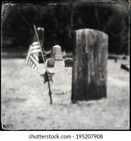 Instagram filtered style image of a Civil War era grave and American Flag