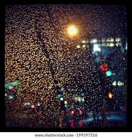 Instagram filtered style image of New York City rainy window.