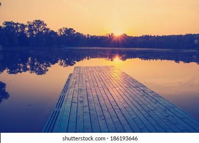 instagram nashville tone orange sunset sunrise lake boat and trees