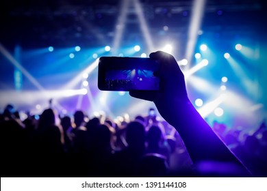 Instagram photo to mobile phone. Concert light performance