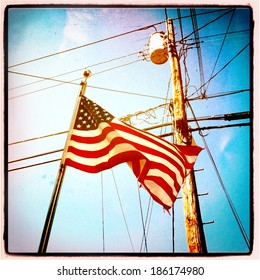 Instagram style image of an American Flag and utility pole