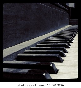 Instagram style image of a dirty old piano keyboard in an abandoned building (best at small sizes)