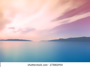 instagram style subtle blurry summer background landscape with trendy colorful filter overlay. Blue ocean with hills and mountains in the distance on a warm pink sunset