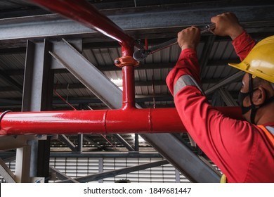 Install fire sprinkler system. In the industrial plant, pipe assembly, red fire pipe, fire protection contractors Using Scissor Lift High work