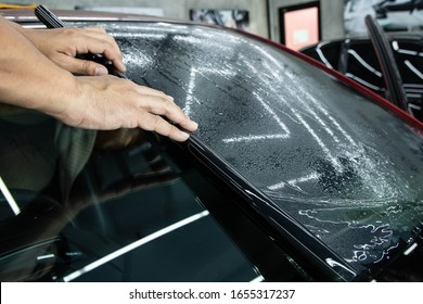 Install front film on the car. Tinted Windows of the car.