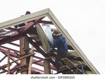 install galvanized sheet flashing on roof structure for waterproofing