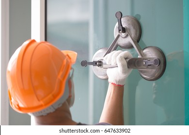 Install glass with suction cup for installation