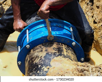 Install a join for a 15 inch diameter main pipe sized burst pipe