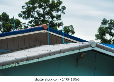Install the sprinkler on the tile roof to reduce the temperature inside the building of house. Sprinkler with automatic system. Home irrigation system watering