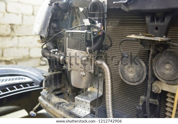 Installation Additional Auxiliary Heater Car Stock Photo