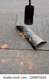 Installation by heating and melting of bitumen rolls by torch to flame while sealing the substrate against ascending moisture. Professional installation of the waterproofing on the concrete foundation
