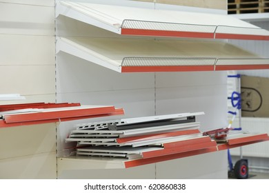 installation of fixtures for product, the installation of the device for sale of goods, pipes, plumbing, chrome-plated products on shelves background