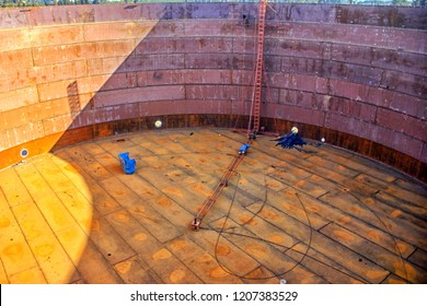 Installation of the inside of the storage tank with floating roof. Storage tanks are containers that hold liquids, compressed gases or mediums used for the short- or long-term storage of heat or cold.