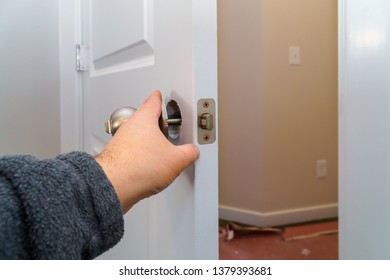 Installation locked interior door woodworker hands install lock