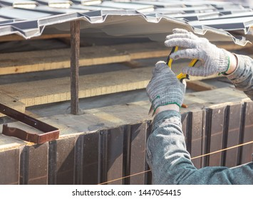 Installation of metal drain on the roof of the house .