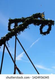 The installation of the midsummer pole at midsummer festivities 2018 in  Glumslöv, Sweden