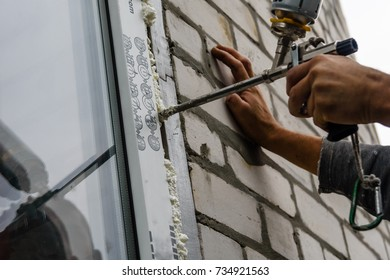 Installation of modern window made of PVC profiles