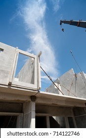 Installation process of prefabricated wall panels for residential buildings.