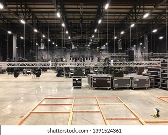 Installation of professional sound, light, video and stage equipment for a concert. Lifting of line array speakers.
