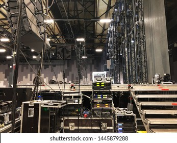 Installation of professional sound, light, video and stage equipment for a concert. Backstage area and tech zone with amplifiers, flight cases and radio microphones.
