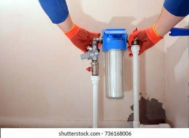 Installation of a reducer and a water filter for water purification.
