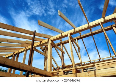 Installation of the roof during the construction frame house