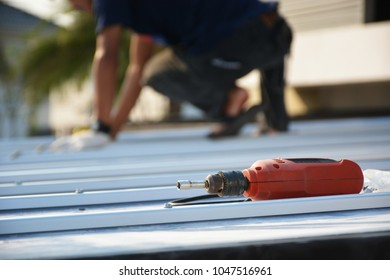 installation roof with screwdriver