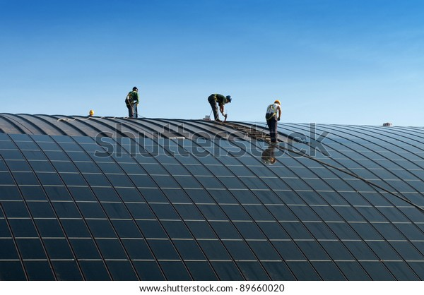 Installation of solar panels on the roof of a building